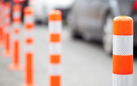 Orange bollard on the road image