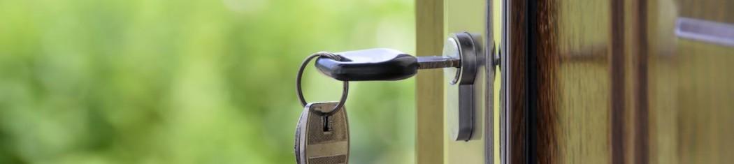 an image of keys in a front door lock
