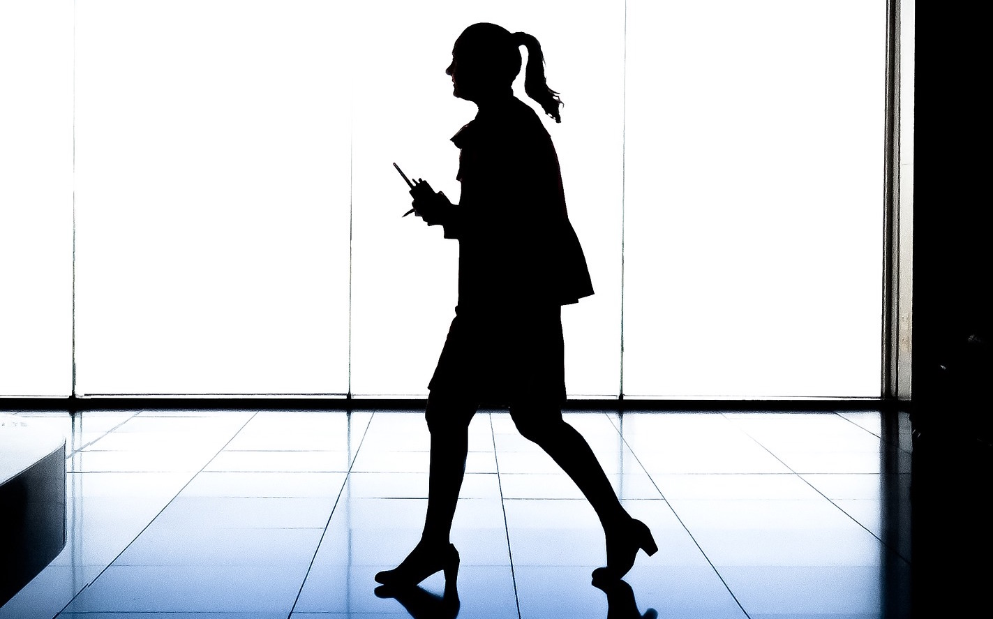 A picture of a woman on her own in an office