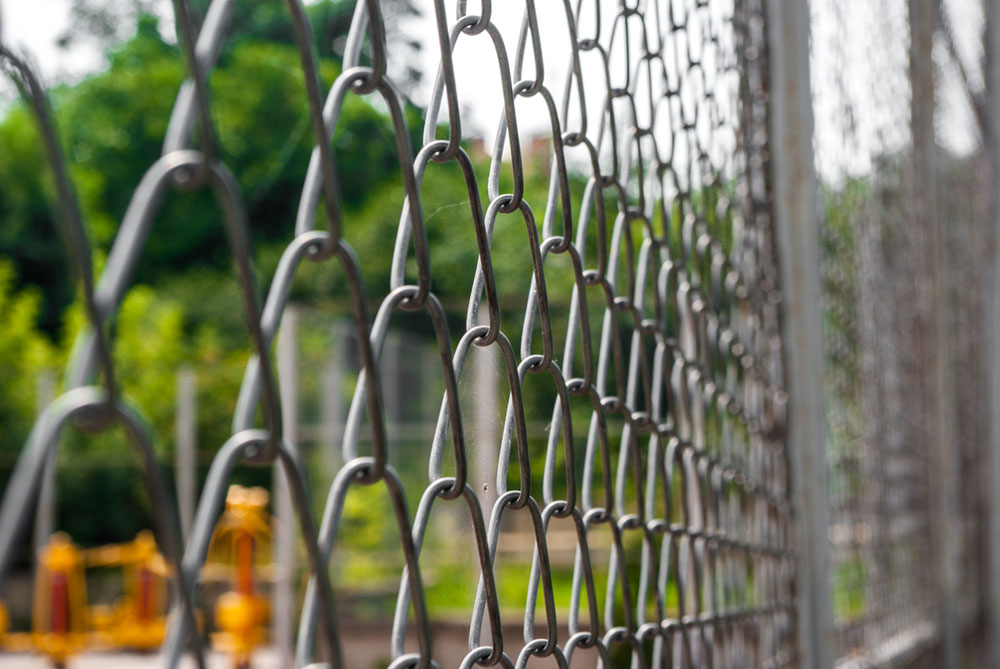 A picture of a Chain link security fence