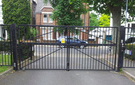 A picture of a large residential swing gate