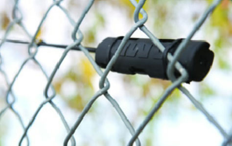 An image of a Movement sensor mounted on a chain link fence