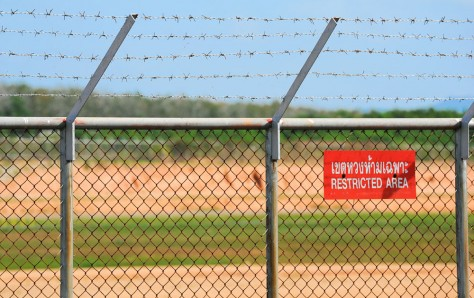 restricted area fence with warning sign