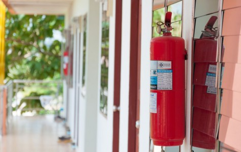 An image of a fire extinguisher outside a building