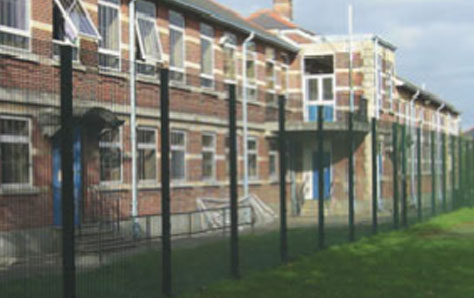 A picture of roll top security fencing outside houses
