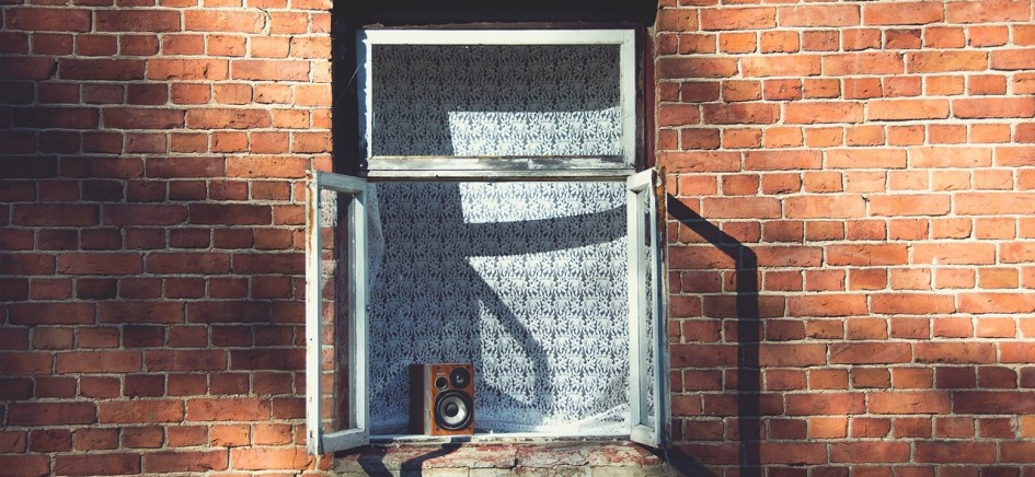 an image of an open window on a brick wall