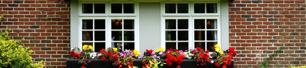 a spring home with flowers and shrubs to improve home security