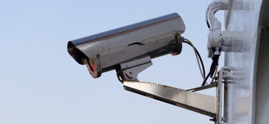 an image of cctv systems installed on wall with blue sky
