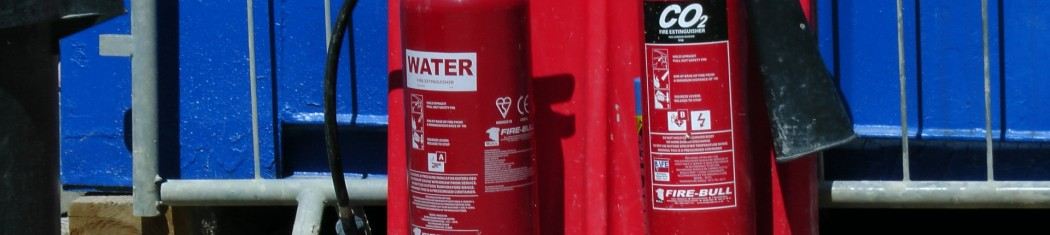 A picture of a water and a CO2 fire extinguisher
