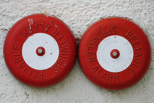 A picture of two fire bells on a wall