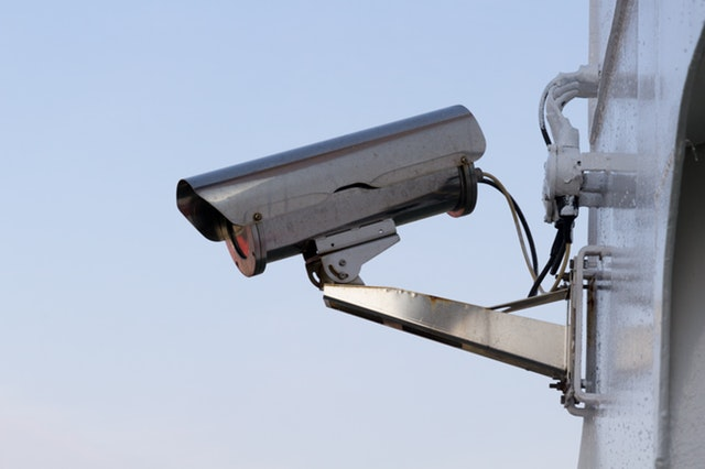 A picture of a CCTV camera on the outside of a building