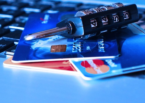 A picture of debit cards and a lock