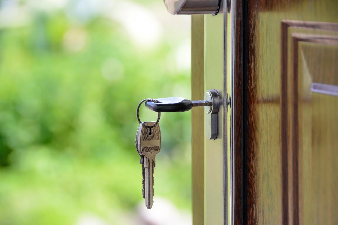 A stock image showing keys in an open door